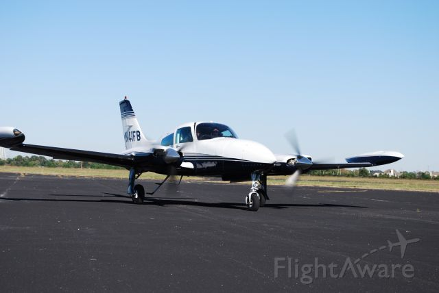 Cessna 310 (N41FB) - On the ramp at Tri-Star Aviation. Just returning from a trip in the 310, on a beautiful flying day.