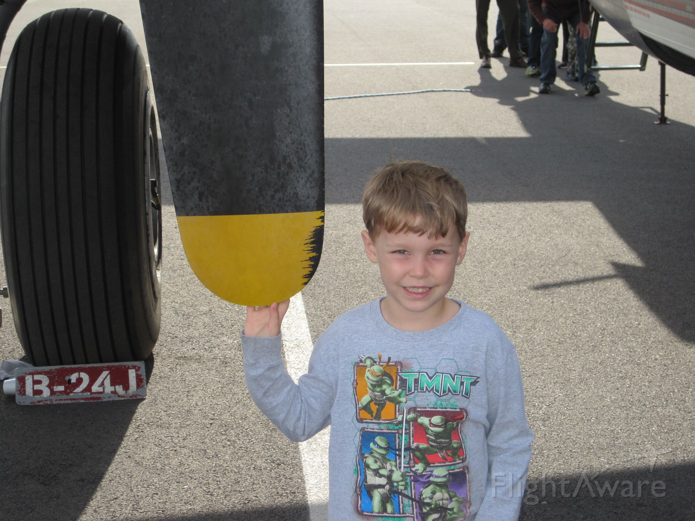 — — - Little boy next to prop on B-24.  Tri Cities Regional Airport Northeast Tennessee