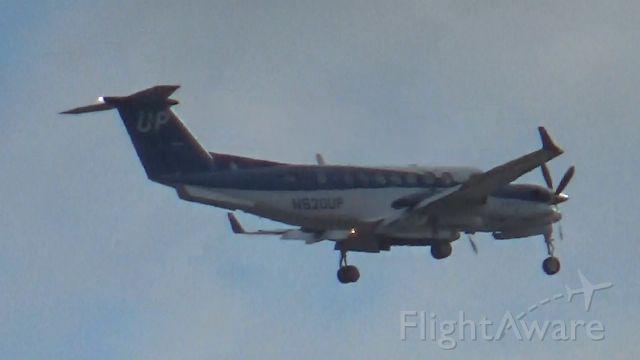 Beechcraft Super King Air 350 (N820UP) - Wheels down actually.