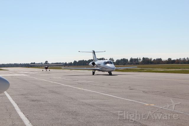 — — - All sorts of aircraft parade into the Gill FBO ramp area as we await our turn to depart.