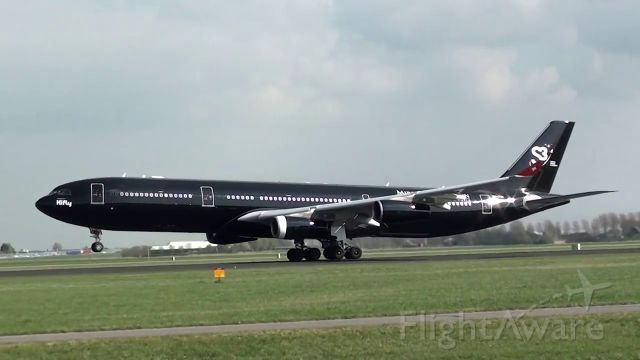 Airbus A340-300 (9H-TQM) - Black Beauty during takeoff from R36L