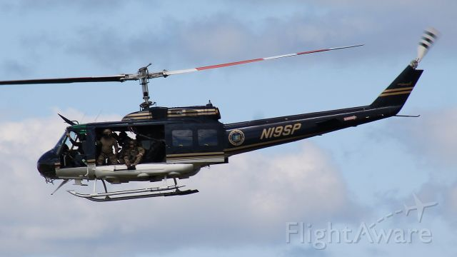 Bell UH-1V Iroquois (N19SP) - Performing a demonstration during the New York International Air Show, 24 August 2019.