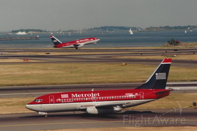 Boeing 737-200 (N256AU) - From June 1999 - One Metrojet departs 22L hile another taxi