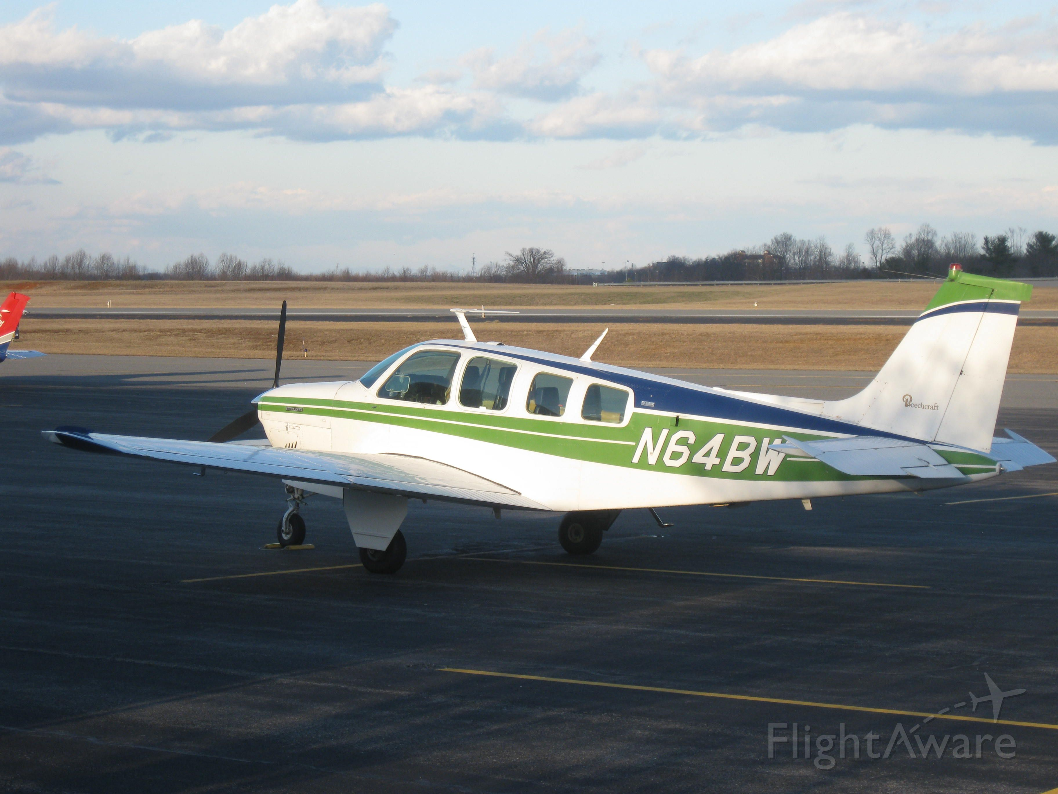 Beechcraft Bonanza (36) (N64BW) - Parked on the general aviation ramp at LYH.