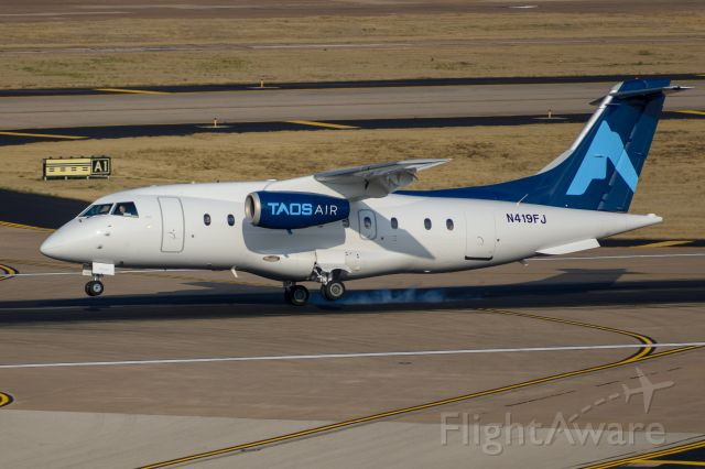 Fairchild Dornier 328JET (N419FJ) - A nice crosswind landing demonstration. Landing at Love Field on 31R with winds from 010 at 15 knots, gusting to 24. Taos Air tiles.