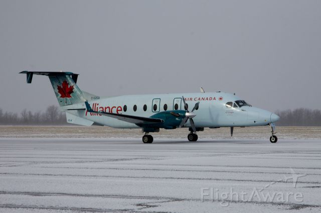 Beechcraft 1900 (C-GZGA) - Beech 1900 makes its way along Taxiway Alpha to Runway 25 for departure to Toronto..