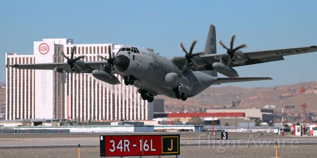 """Lockheed C-130 Hercules (96-5300) - The second of a pair of 403 WG """"Hurricane Hunters"""" WC-130J Hercs is just off 16L and beginning to tuck the wheels in the wells as it makes a noon-hour departure from Reno Tahoe International to end a RON visit."""