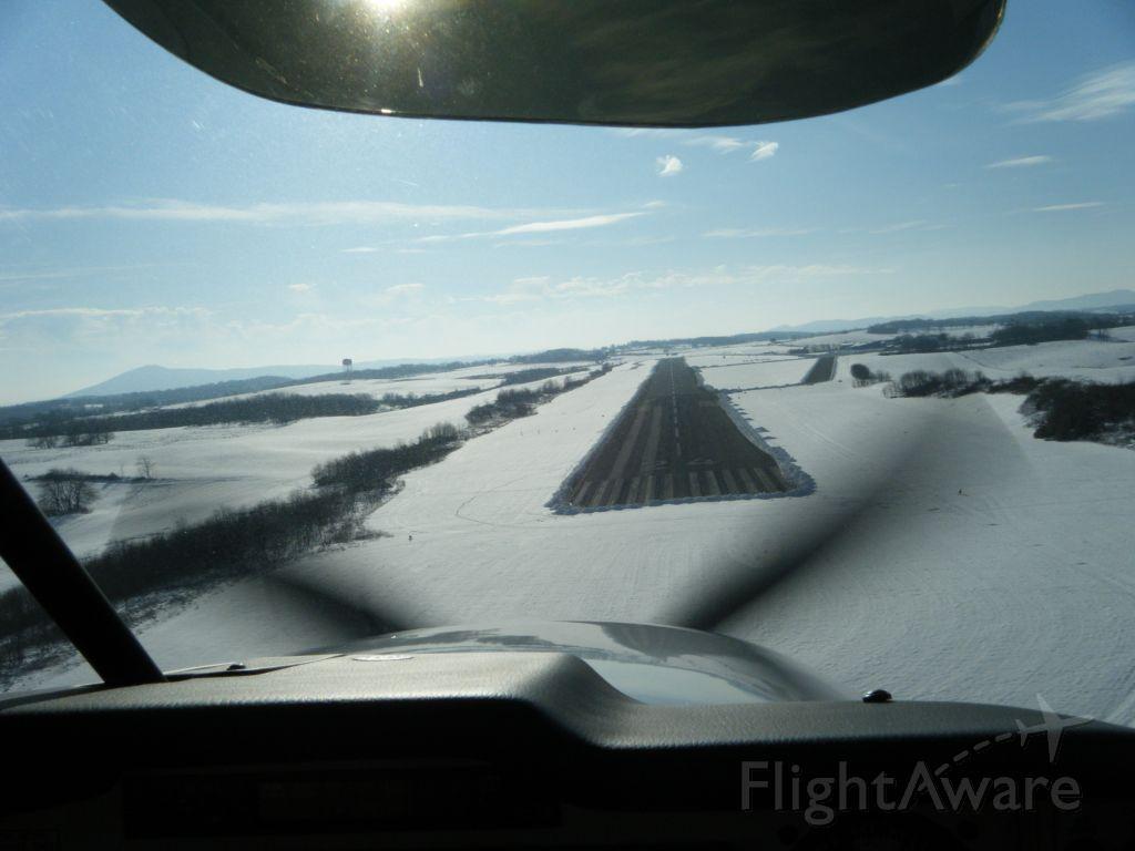 Mooney M-20 (N62KH) - Landing at KPSK after the big snow.