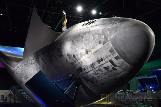 — — - Photo of underside Space Shuttle Atlantis OV-104 and her heat shield tiles after STS 135