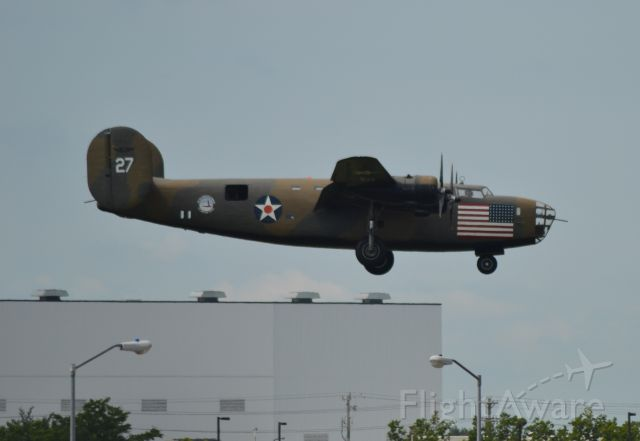 """Consolidated B-24 Liberator (N24927) - N24927 Consolidated B-24 """"Diamond LIL"""" landing in Sioux Falls SD on 08-12-2013"""