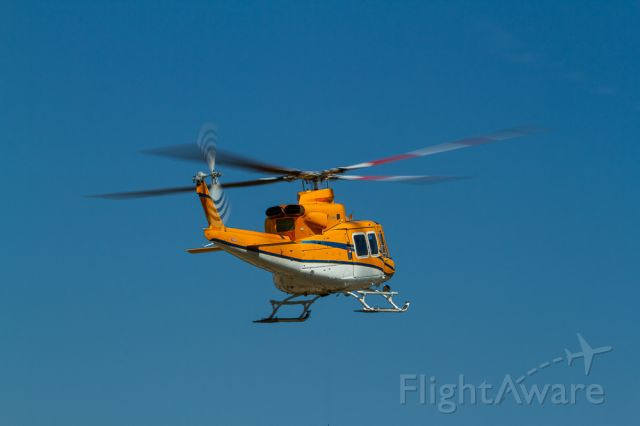 Bell JetRanger (C-GTWP) - Lift off into the clear blue yonder.