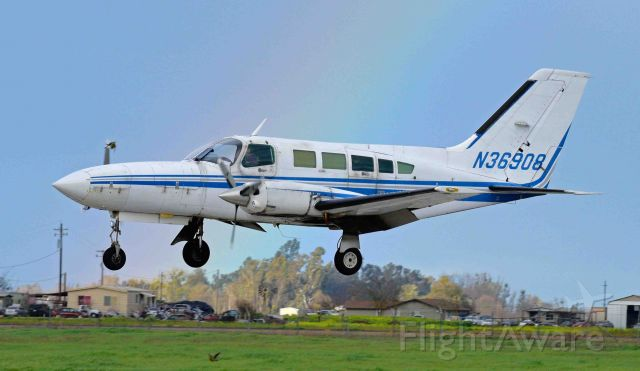 Cessna 402 (N36908) - A rainbow in in the background