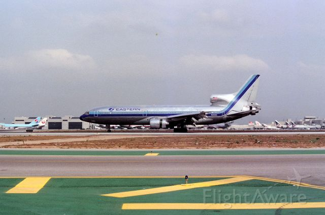 Lockheed L-1011 TriStar (N302EA) - KLAX - Eastern L-1011 arriving LAX Sept 1990s on 25L from MIA and turning for the hold bars at 25R. N781DL Last Airline Delta Air Linesbr /br /Serial number 1003br /Type L-1011-1br /First flight date 01/06/1971br /Test registration N301EA