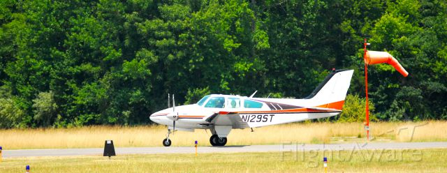Beechcraft Baron (58) (N129ST) - As seen on takeoff roll just before rotate speed leaving M34.