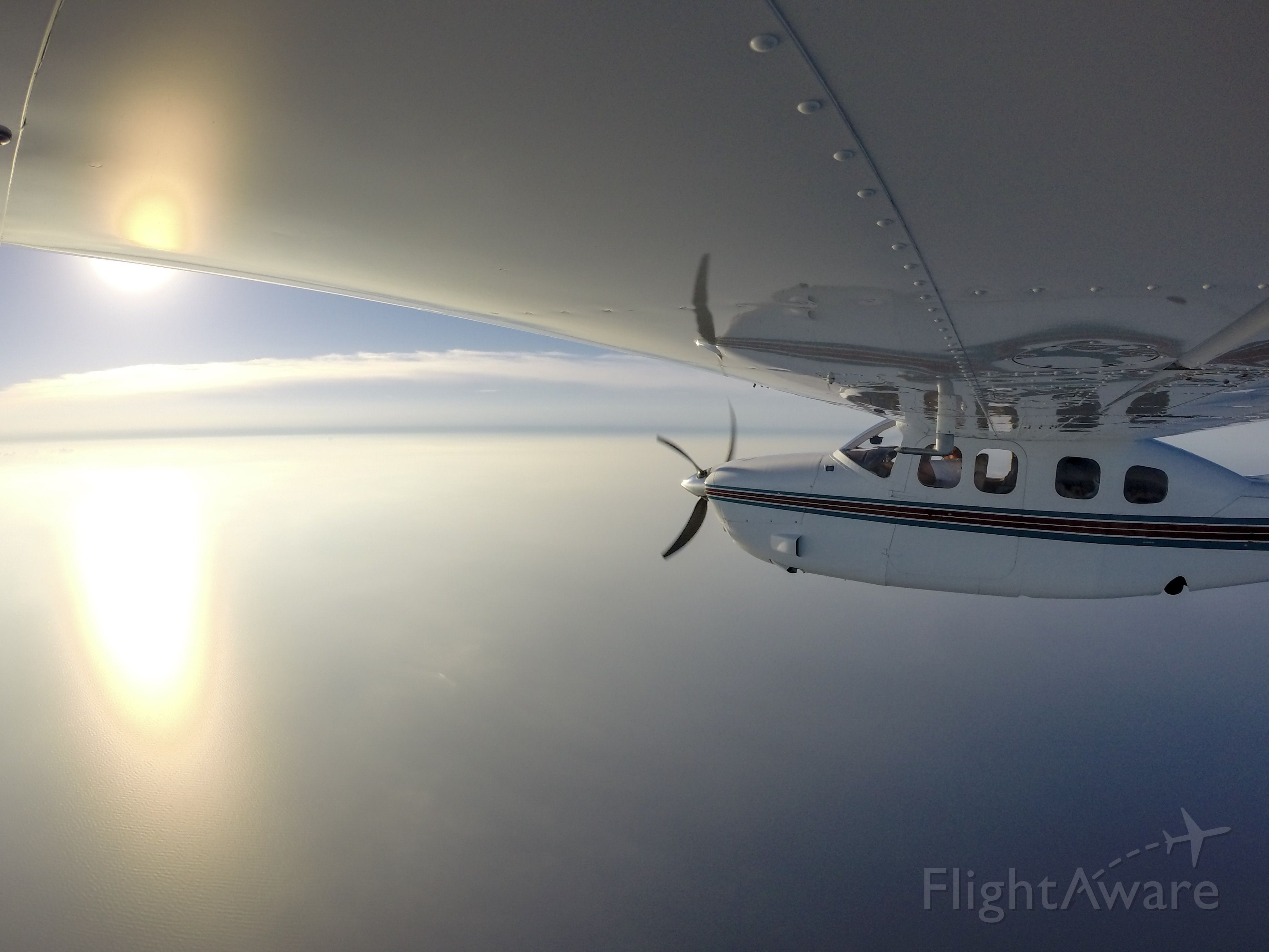 Cessna Centurion (N92CK) - Crossing lake Michigan on the way to Oshkosh 2019, racing the sun to get there before it closed