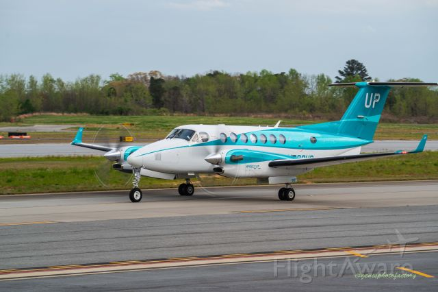 N391AF — - Wheels Up  charter aircraft taxiing to a parking spot.  I shooting from the aviation platform near the tower.
