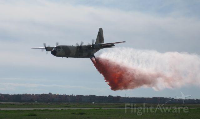 Lockheed C-130 Hercules — - C-130 simulated water bombing in Marrakech, Morocco at AeroExpo 2010