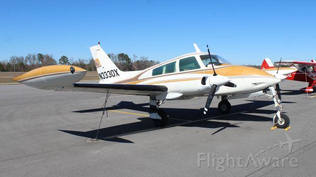 Cessna 310 (N3330X) - A 1967 Cessna 310L tied down on the ramp at Thomas J. Brumlik Field, Albertville Regional Airport, AL - February 25, 2017.