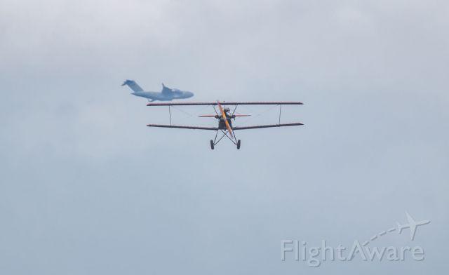 — — - Alumium overcast above a Fleet Model 2 biplane.