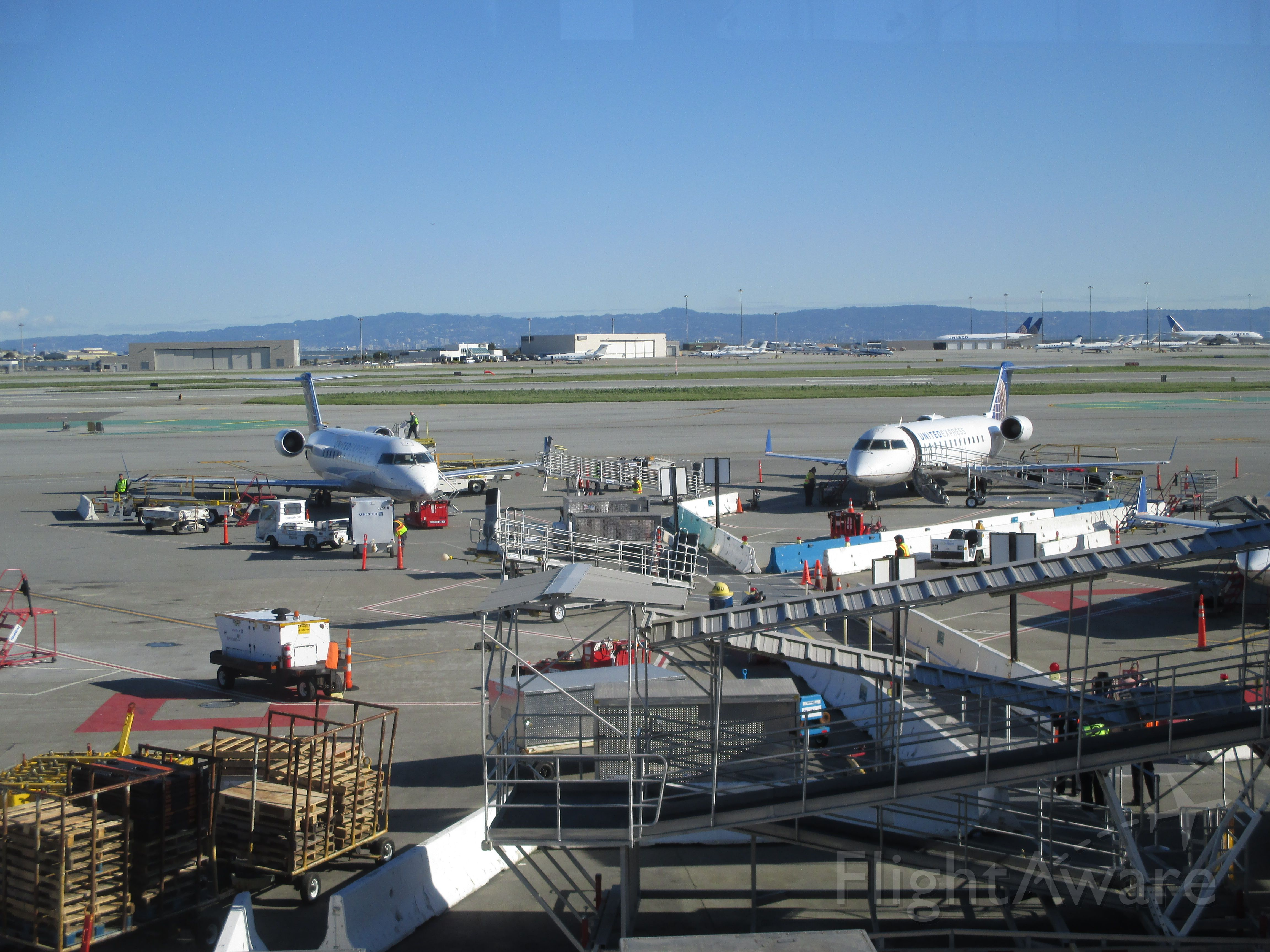 Canadair Regional Jet CRJ-200 — - Waiting to board my flight to Ontario.