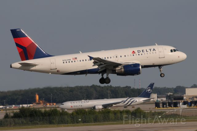 Airbus A319 (N362NB) - Delta Skyteam 767-400 in the back-ground.