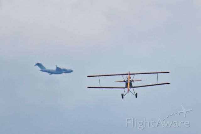 VH-FLF — - As it happened.  A Fleet 2 biplane with a C17 Globemaster passing behind.