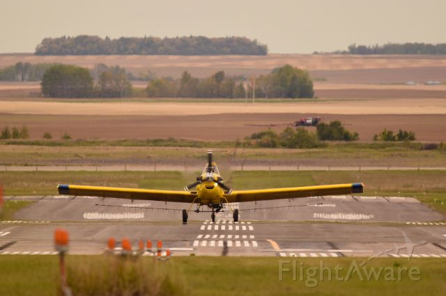 — — - This Air Tractor AT-502B just arrived after field appliction with some  competition in the field behind
