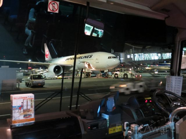 Boeing 777-200 — - Catching a bus to our flight at a remote gate
