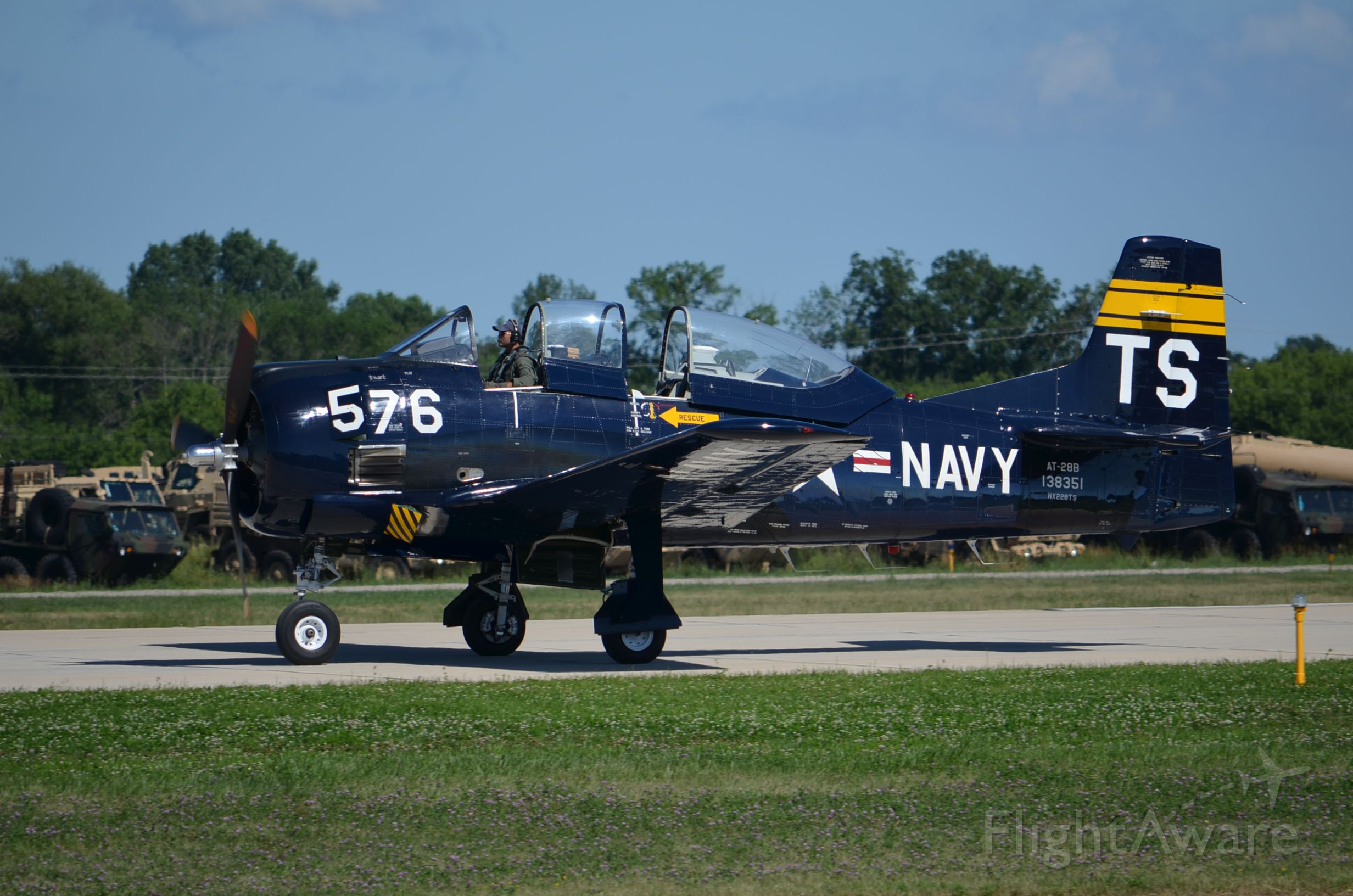 North American Trojan — - EAA 2011 T-28 taxiing back to warbirds area.