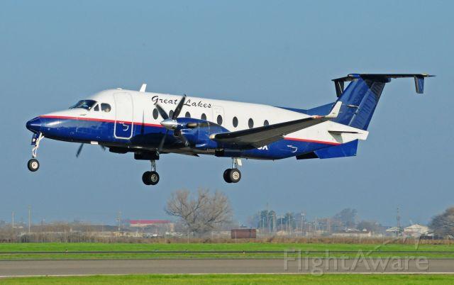 Beechcraft 1900 (N122UX) - Lakes 197 landing runway three-zero, Merced Regional Airport.