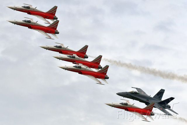 """Northrop RF-5 Tigereye (J3091) - The """"Patrouille Suisse"""", aerobatic team of the Swiss Air Force during the demonstration in Thun, Switzerland. (08-17-2019)br /J-3091 is the aircraft of the leader."""