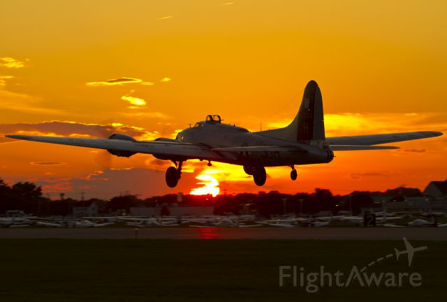 Boeing B-17 Flying Fortress (N5017N) - Takeoff into the sunset, RWY 27
