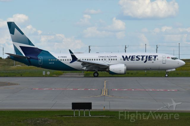 Boeing 737 MAX 8 (C-FNWD) - Westjets new livery arrives in Calgary on June 21.