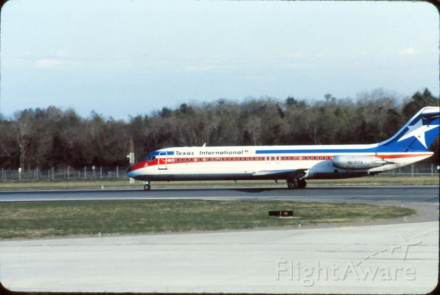 McDonnell Douglas DC-9-30 (N531TX) - January 1983.  Shot from terminal.