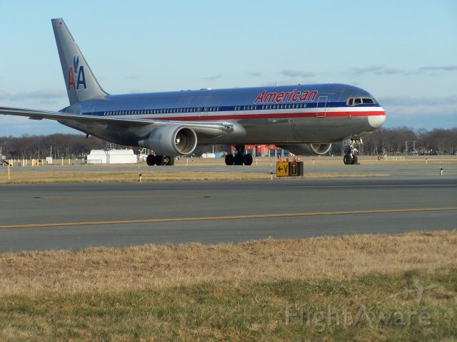 BOEING 767-300 (N351AA) - N351AA sits on the southern end of taxiway victor at TF Green Providence on Saturday 24th December. It had arrived from Fort Lauderdale on Friday 23rd with the Miami Dolphins, and returned the team home after their game with the New England Patriots!