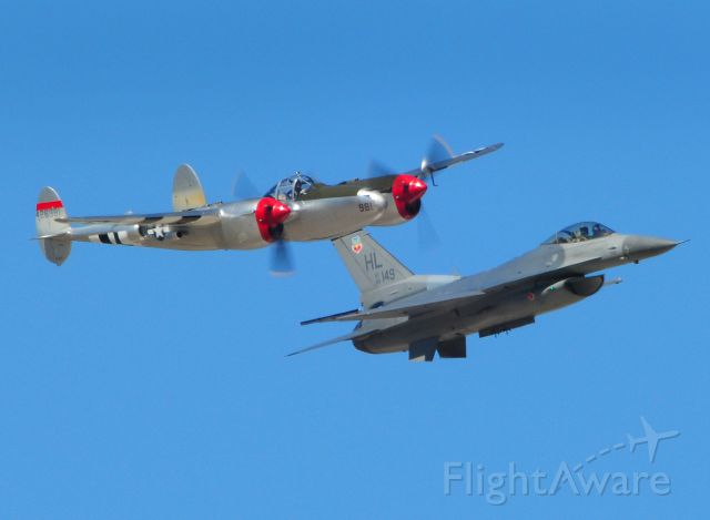"""— — - USAF Heritage formation flyover with Lockheed P-38 Lighting """"Honey Bunny"""" and on left wing F-16 Falcon from Hill AFB, during 2012 Capitol Air Show, Mather Airfield, Rancho Cordova, Ca. KHMR, HMR"""