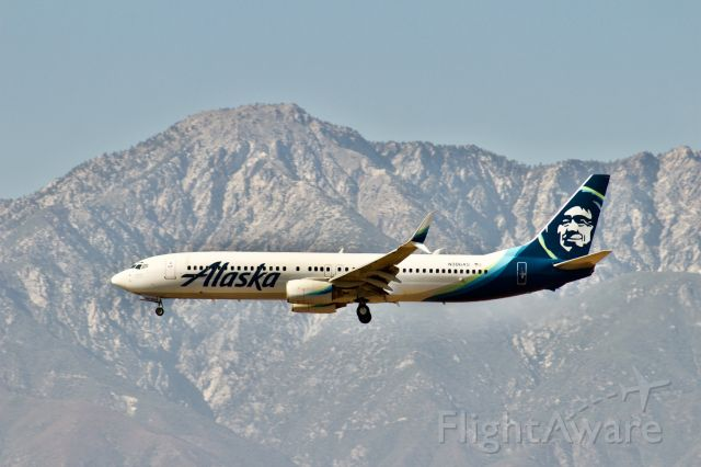 Boeing 737-900 (N306AS) - Alaska 737-900 on short final to Ontario's 26R with the beautiful San Gabriel mountains in the foreground