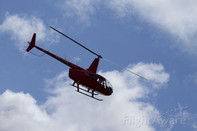 Robinson R-66 (VH-VRK) - Driving past heli pad