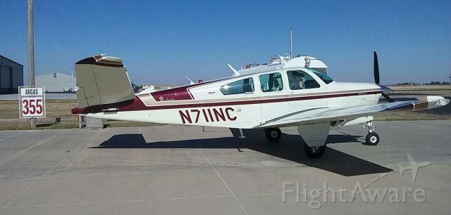 Beechcraft 35 Bonanza (N711NC) - N711NC at DUX - check out that AVGas price!