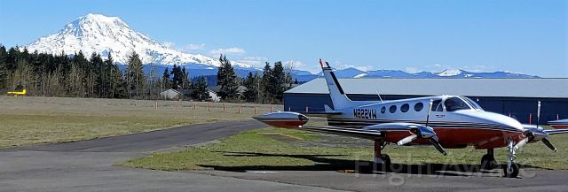 """Cessna 340 (N822VW) - Million dollar photo of Mount Rainier and a Cessna 340 from the ramp at Thun Airfield in Pierce County, WA. This is what the """"other"""" Washington looks like on a clear day."""