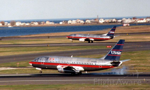Boeing 737-200 (N246US) - US Air dual landing - 737-200 on 4L and B737-400 on 4R
