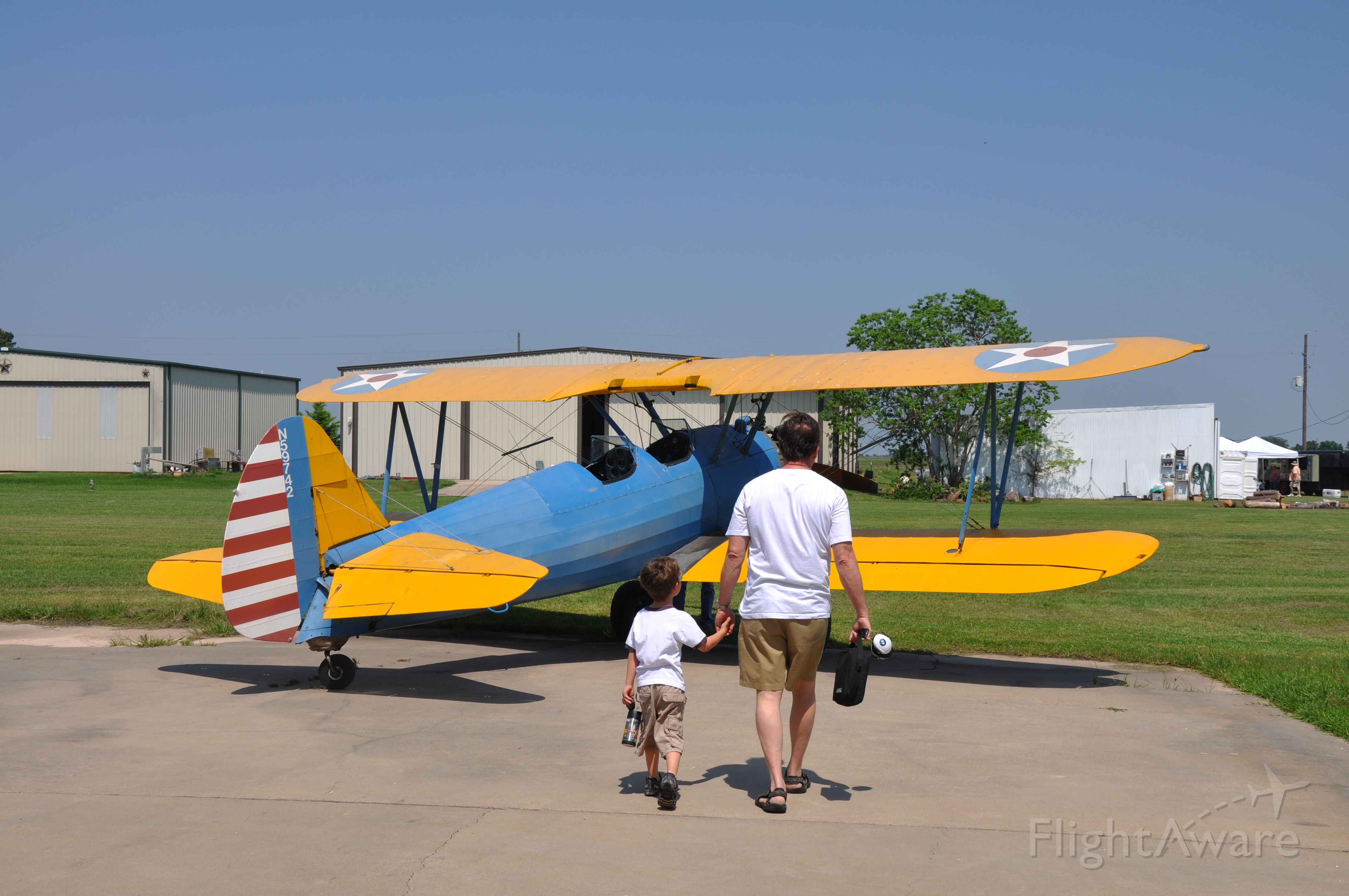 """Boeing PT-17 Kaydet — - """"Dad, I have PLENTY of 182 time.  How about I log some Stearman time in Mike's plane?""""  """"No problem bud, lets take her up.  She isn't fast but can take more G's than you and I combined."""""""