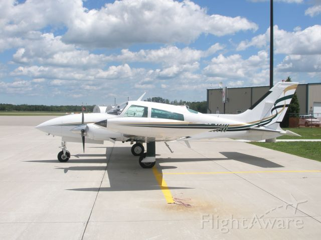 Cessna 310 (N310KW) - Parked on the ramp at PHN.  Don