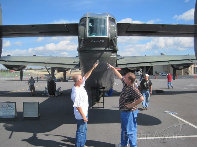 — — - Tail end of B-24.