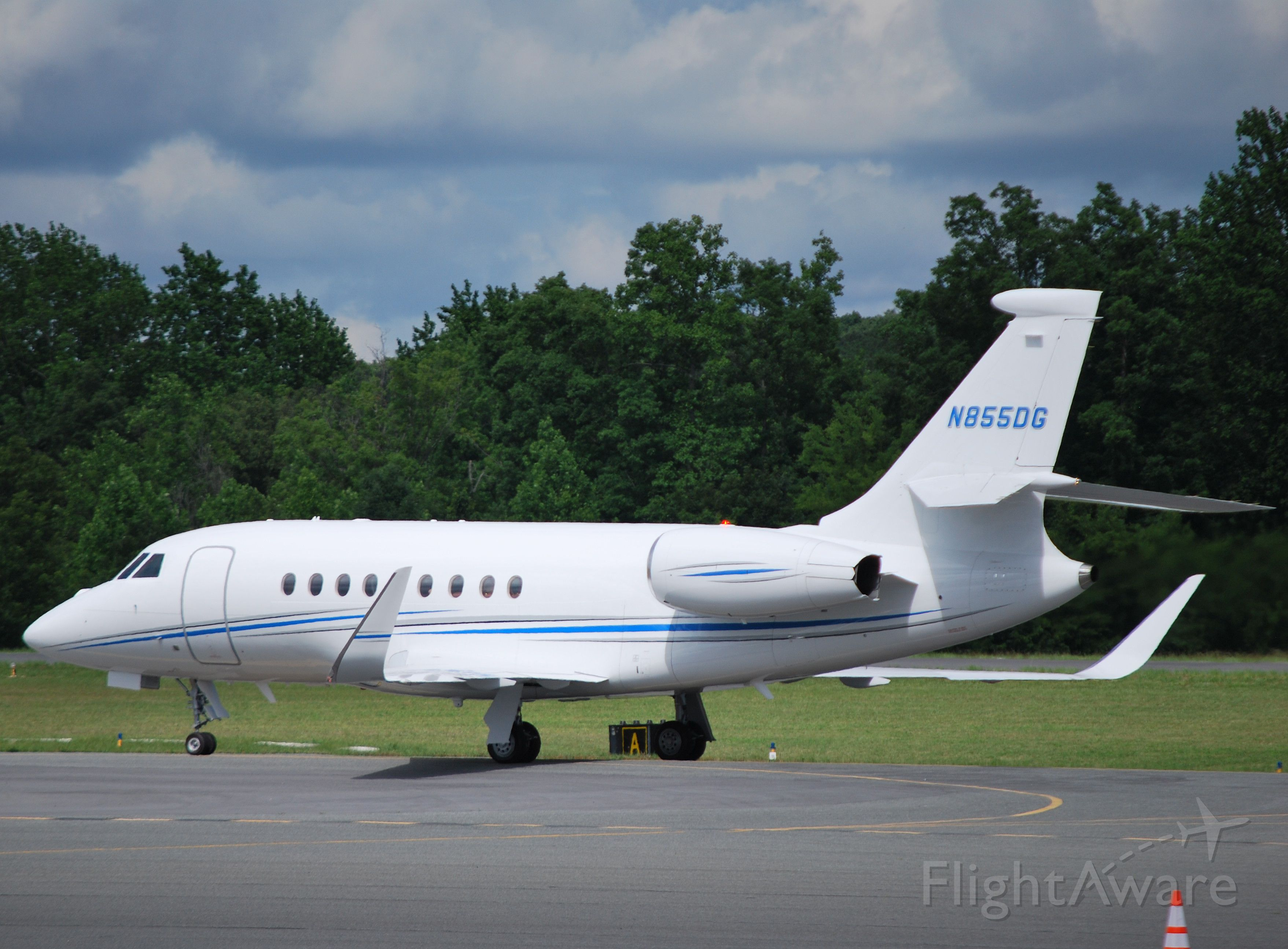 Dassault Falcon 2000 (N855DG) - DOLLAR GENERAL CORP taxiing to Hendrick Motorsports hangar to drop off passengers attending the Coca-Cola 600 at KJQF - 5/27/12