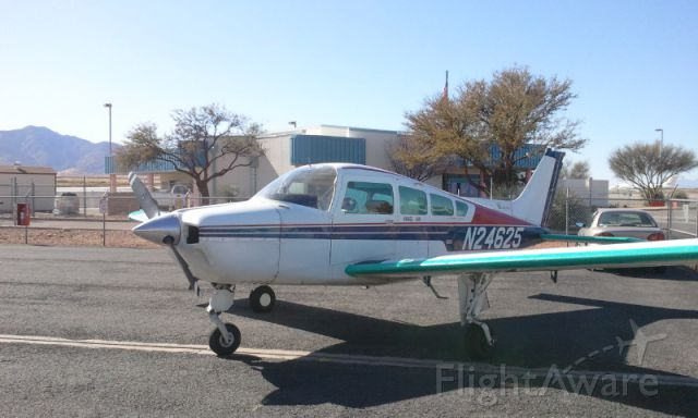 Beechcraft Sierra (N24625) - airplane being ready for flight outside hanger