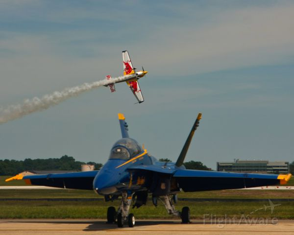 McDonnell Douglas FA-18 Hornet (16-3468) - Kirby Chambliss flies the Red Bull Edge 540 behind Blue Angel #7 during his performance.