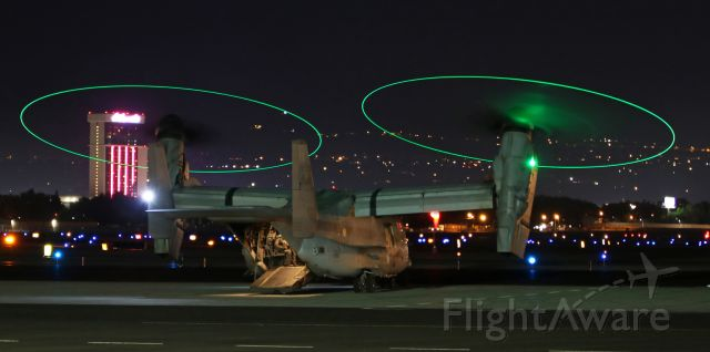 "Bell V-22 Osprey (16-8018) - In this 10:05 PM photo, a VMM 163 MV-22B Osprey (168018) has just completed a ""hot refuel"" (props continue to run while the aircraft is refueled) and is preparing to lift off from the Atlantic Aviation ramp.  NOTE: Smoke from a lightning-caused wildfire burning northwest of the airport was drifting in at ground level and the green light was reflecting off the dense smoke, creating a green ""cloud"" near the starboard prop."