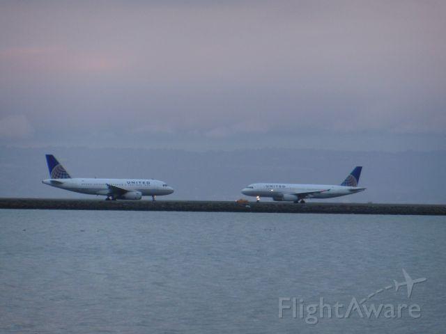 Airbus A319 — - The twins reunite! Sorry for bad quality, just a 14 year-old photographer on a low budget.