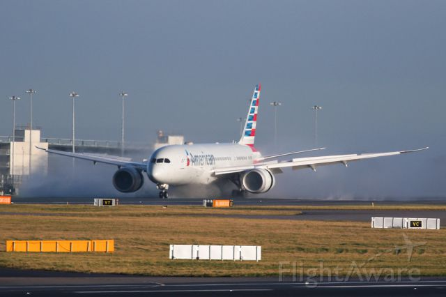 Boeing 787-8 (N809AA) - A delayed AA734 arrives from PHL and clears some water from the runway.